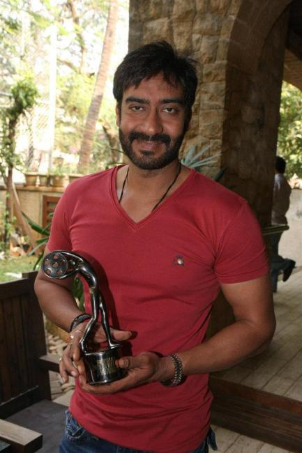 Ajay Devgan with his Bhaskar Bollywood Awards